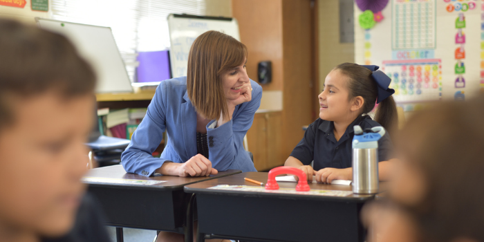 Superintendent Kathy Hoffman chats with a student in Nogales, AZ